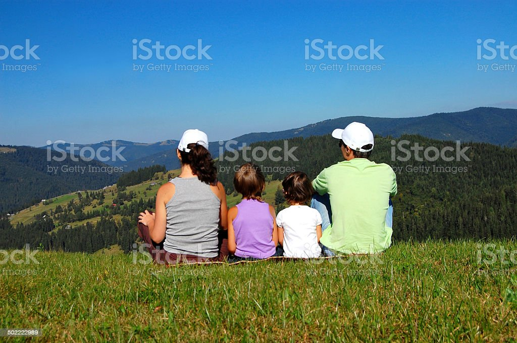 Family travel vacation in mountains stock photo