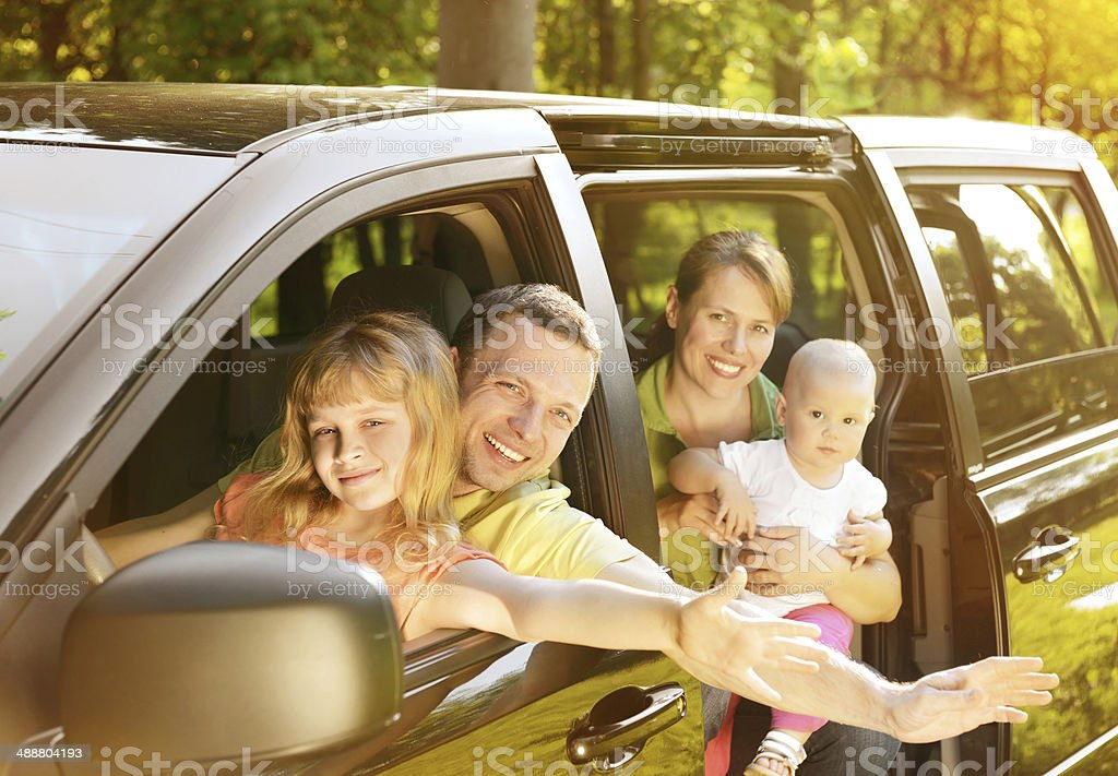 family traveling by car stock photo