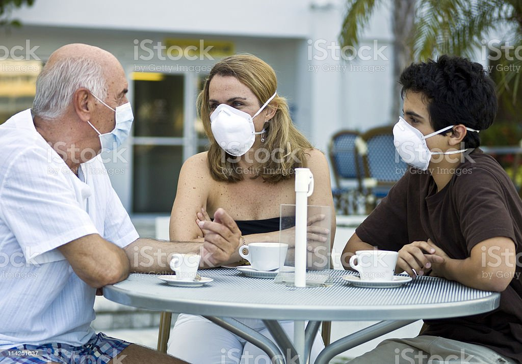 Family under swine flu pandemic stock photo