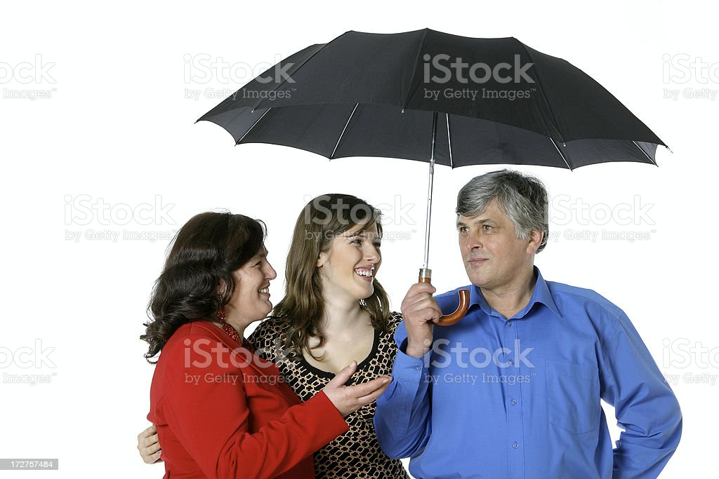 Family under umbrella royalty-free stock photo