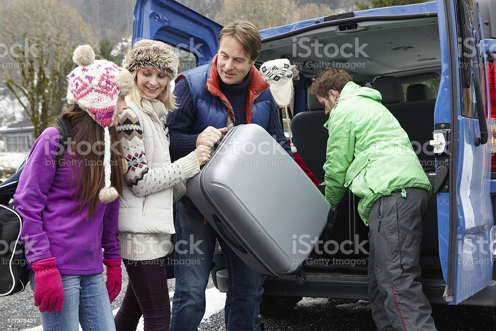 Family Unloading Luggage From Van Outside Chalet royalty-free stock photo