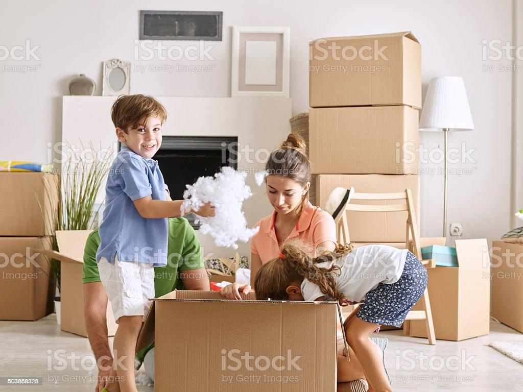 Family Unpacking Cardboard Box stock photo