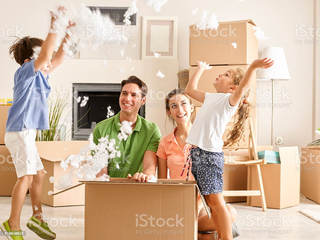 Family Unpacking Cardboard Box stock photo
