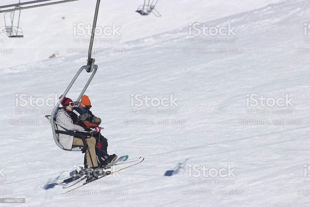 Family using chair lift at CERRO CATEDRAL - Patagonia stock photo