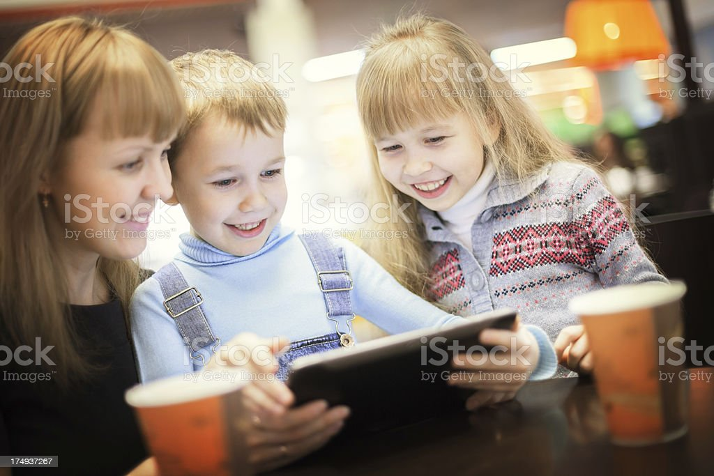 Family using digital tablet in cafe royalty-free stock photo