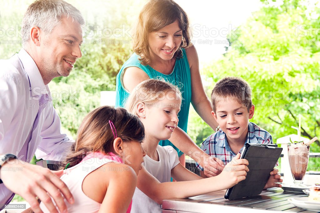 Family using digital tablet stock photo
