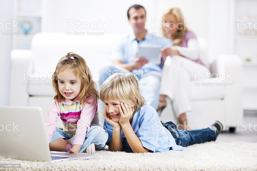 Family using laptop and digital tablet royalty-free stock photo