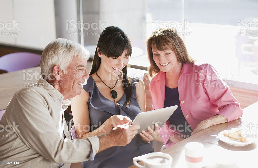 Family using laptop computer in cafe stock photo