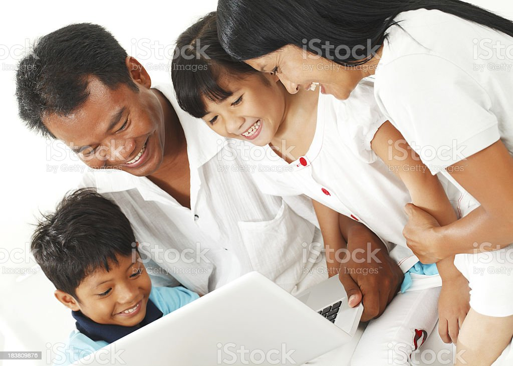 Family using laptop computer royalty-free stock photo