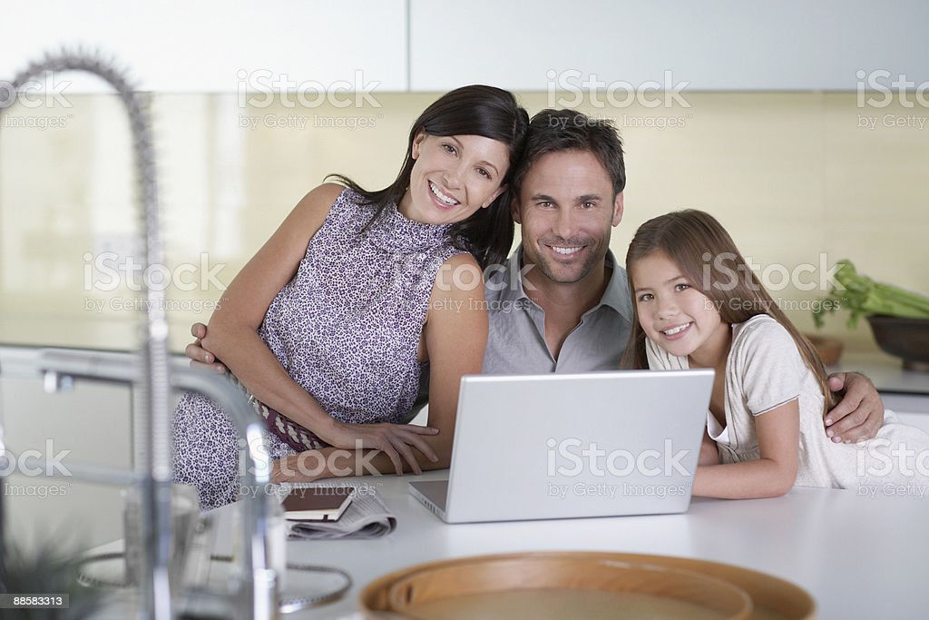 Family using laptop in kitchen royalty-free stock photo