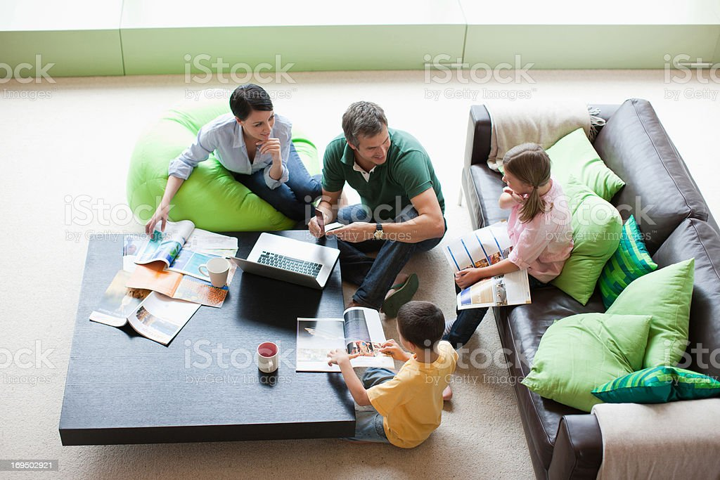 Family using laptop together in living room royalty-free stock photo