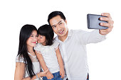 Family using smartphone for taking picture