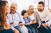 Family using smartphones