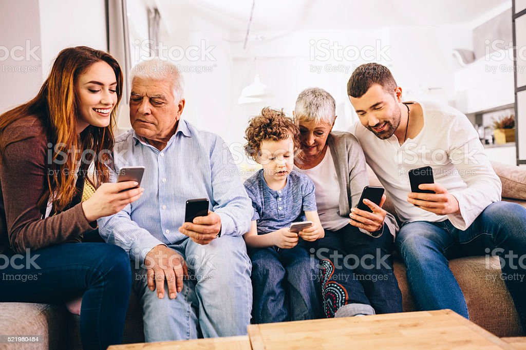Family using smartphones stock photo