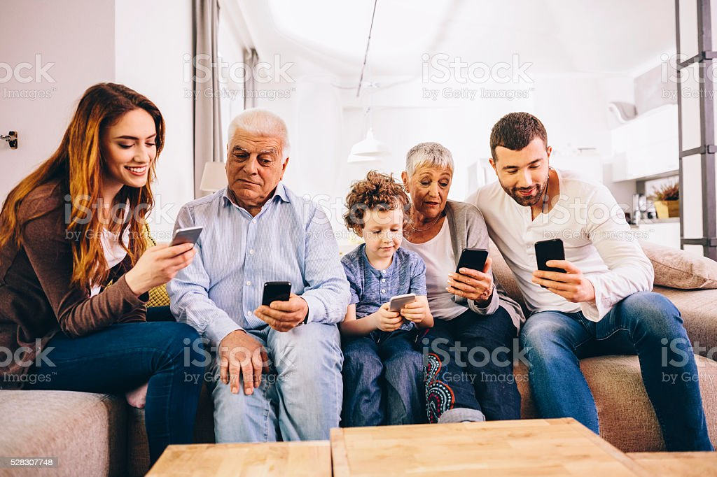 Family using smartphones stock photo