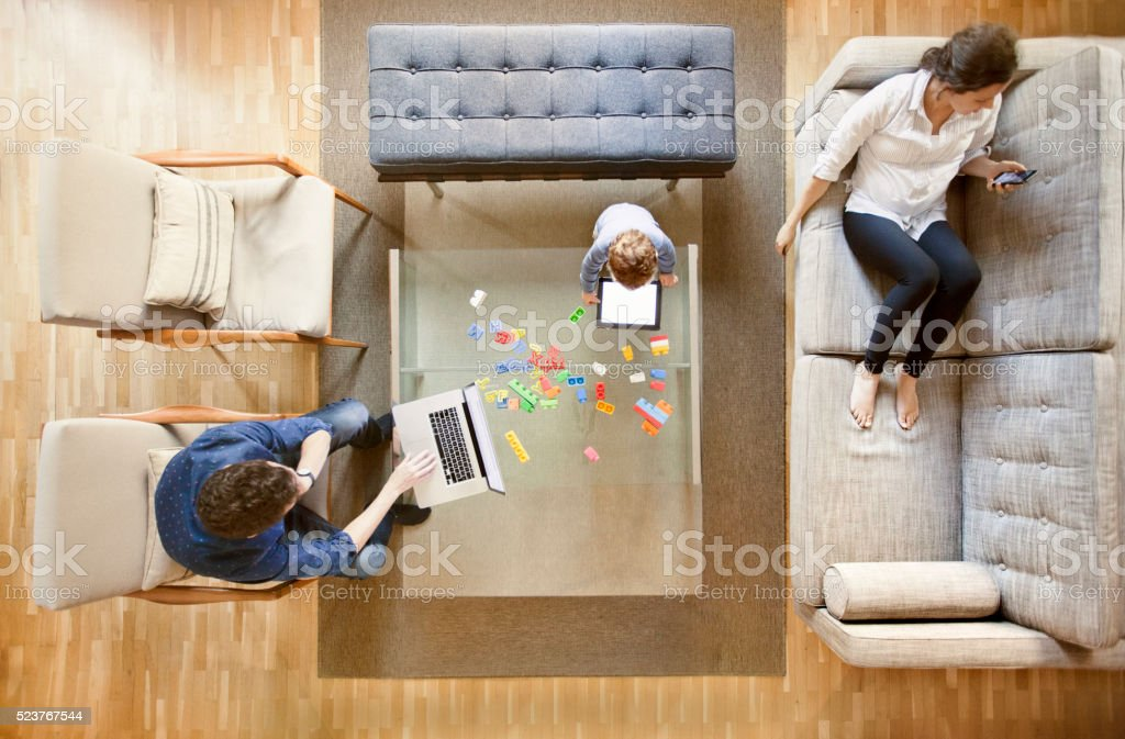 Family using technology stock photo