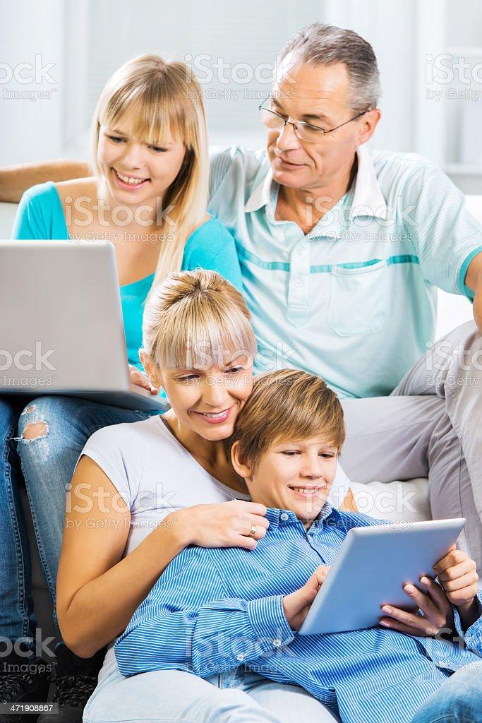Family using wireless technology. royalty-free stock photo