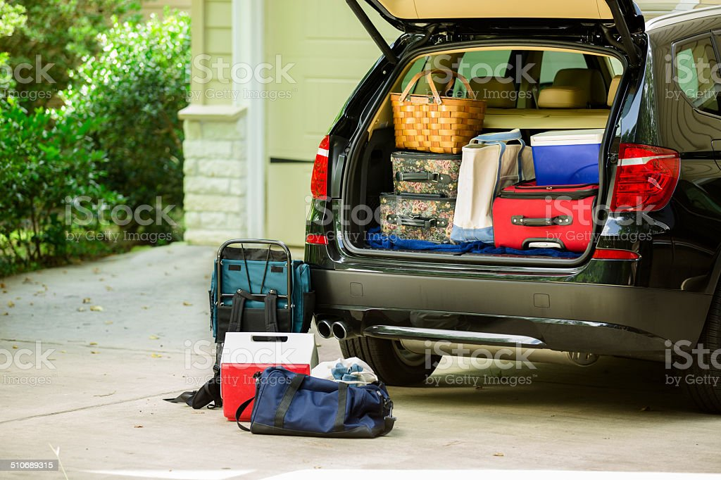 Family vehicle packed, ready for road trip, vacation outside home. stock photo