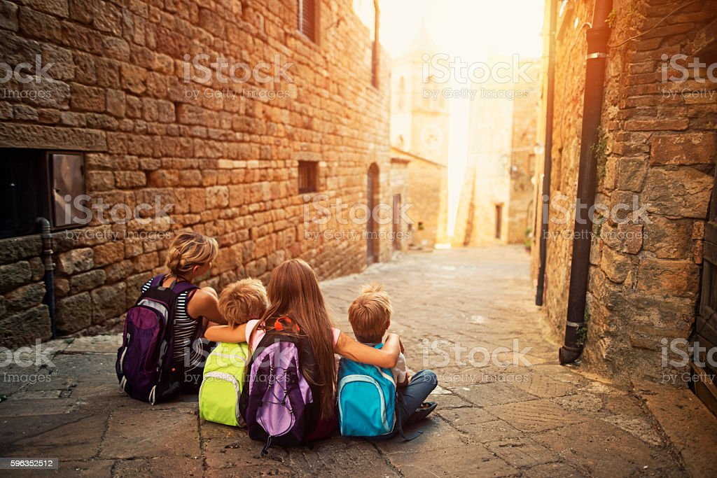 Family visiting beautiful Italian town stock photo