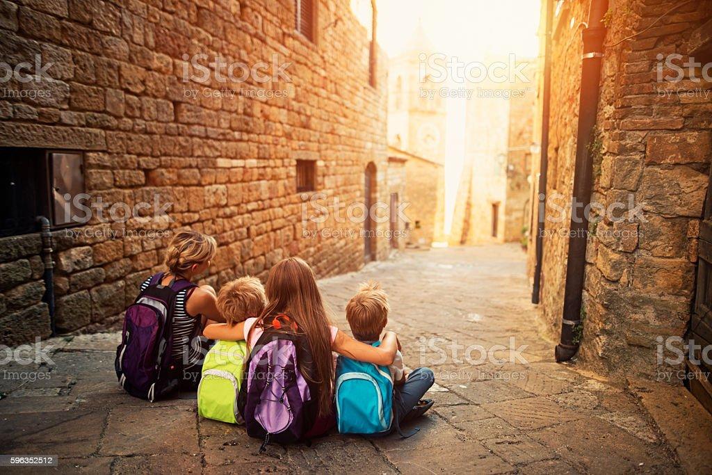 Family visiting beautiful Italian town stock photo