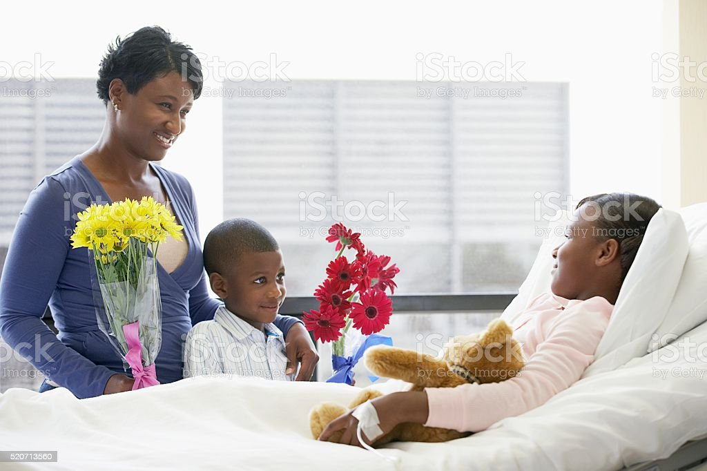 Family visiting daughter in the hospital stock photo