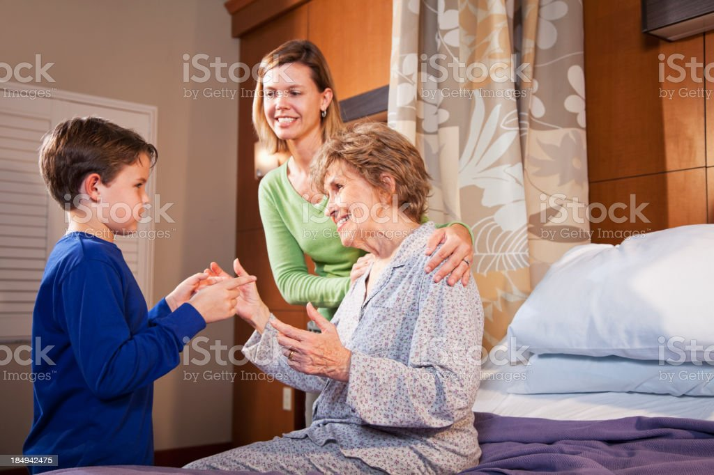 Family visiting grandmother in hospital royalty-free stock photo