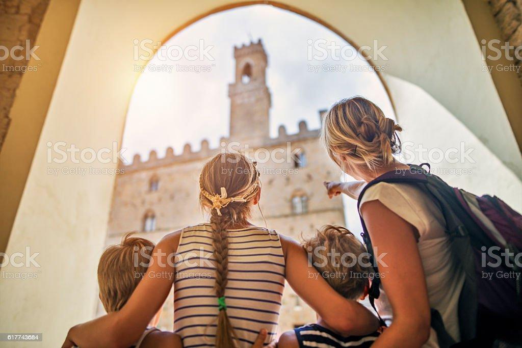 Family visiting italian town of Volterra, Tuscany stock photo