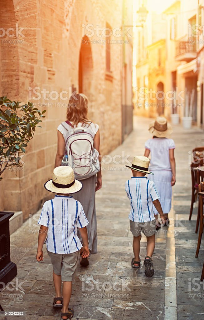 Family visiting mediterranean town of Alcudia stock photo