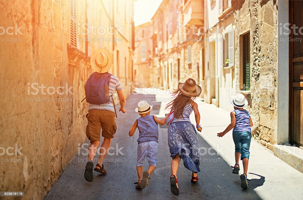 Family visiting mediterranean town on Majorca stock photo