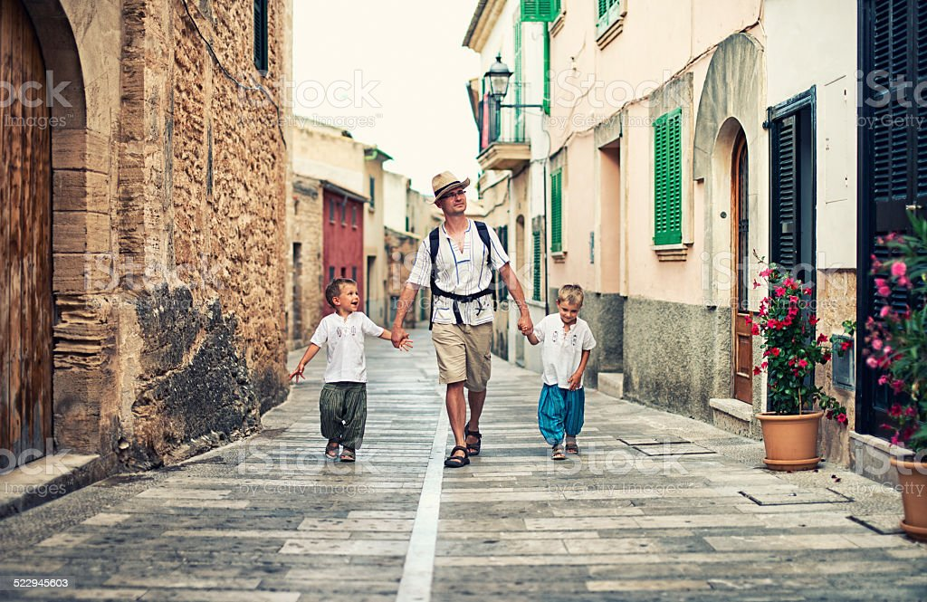 Family visiting mediterranean town. stock photo