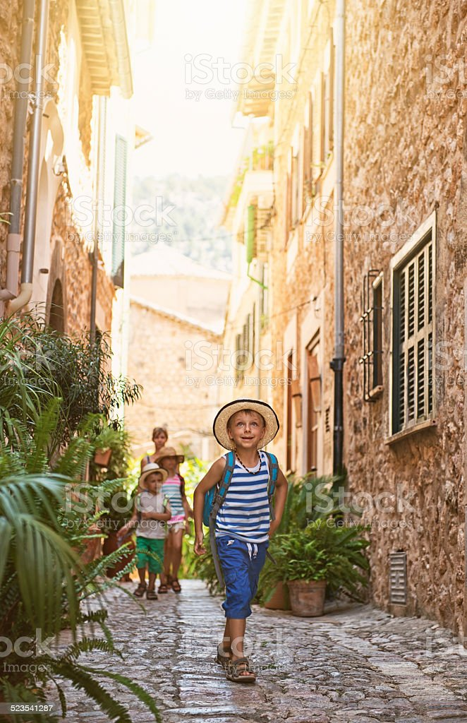 Family visiting mediterranean town. stock photo