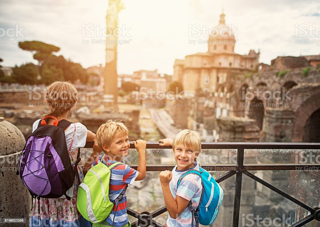 Family visiting Roman Forum in Rome, Italy stock photo