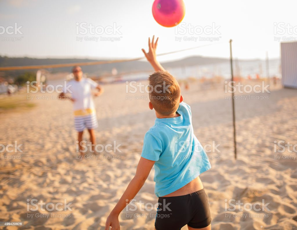 Family volleyball on beach stock photo