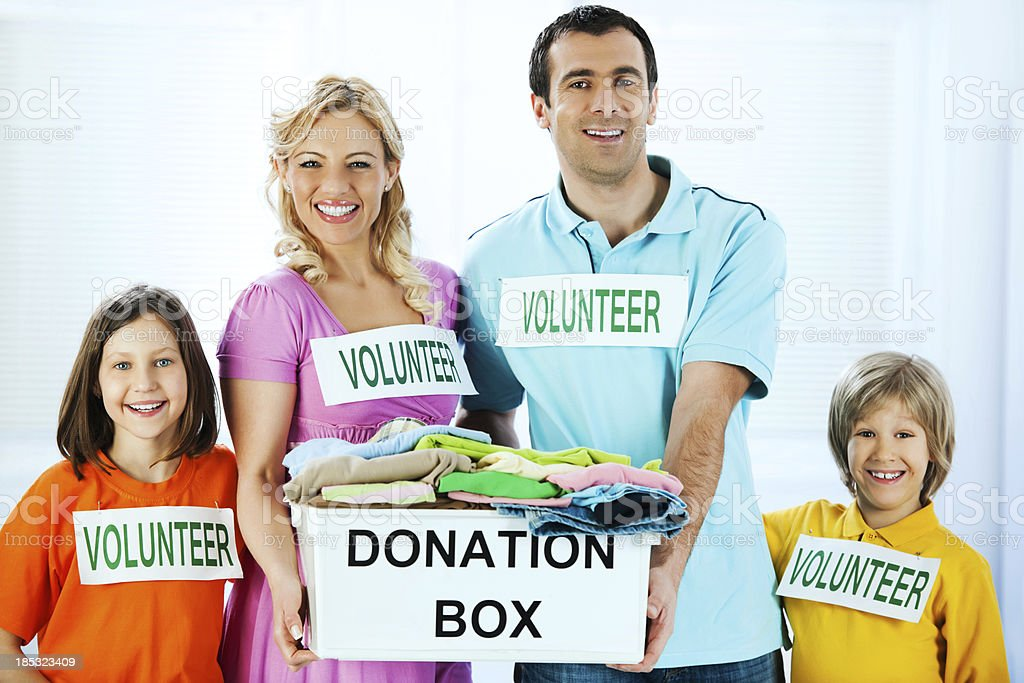 Family volunteers holding full donation box. royalty-free stock photo