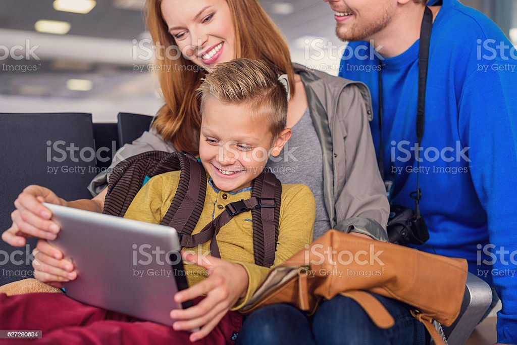 Family waiting for departure at airport stock photo