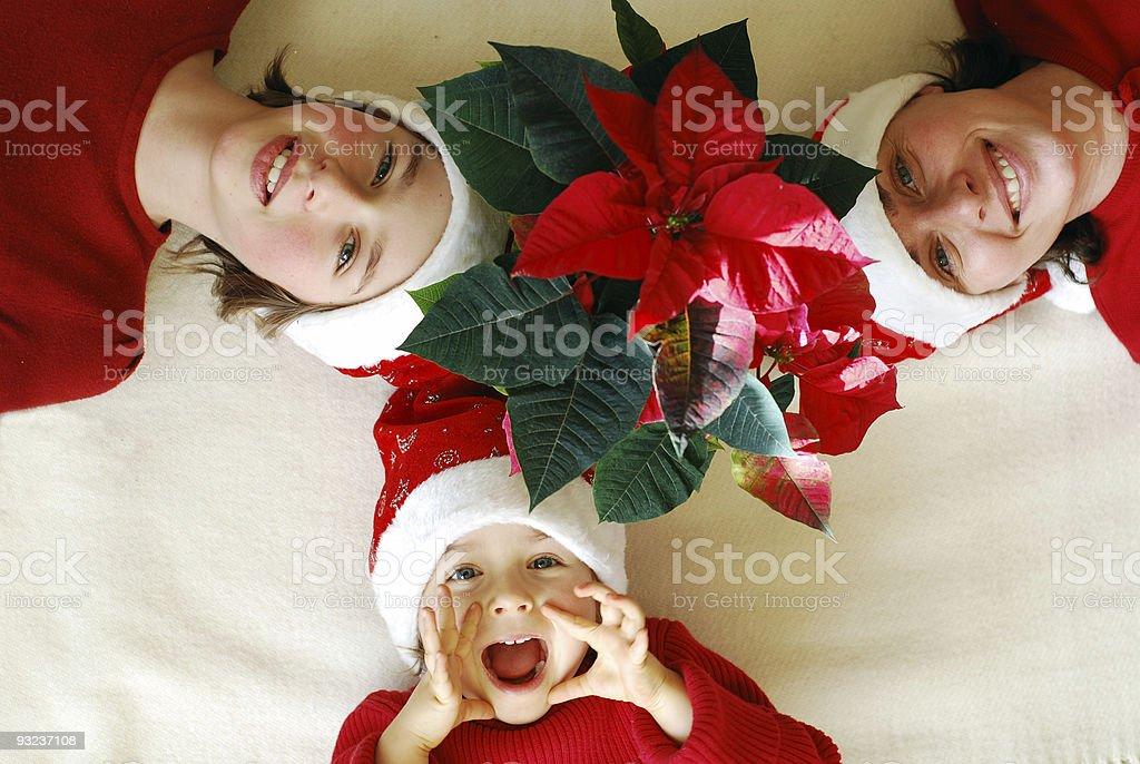 Family waiting under Euphorbia Pulcherrima for christmas royalty-free stock photo