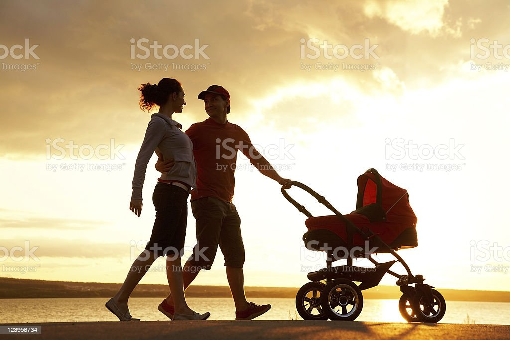 Family walk at sunset royalty-free stock photo