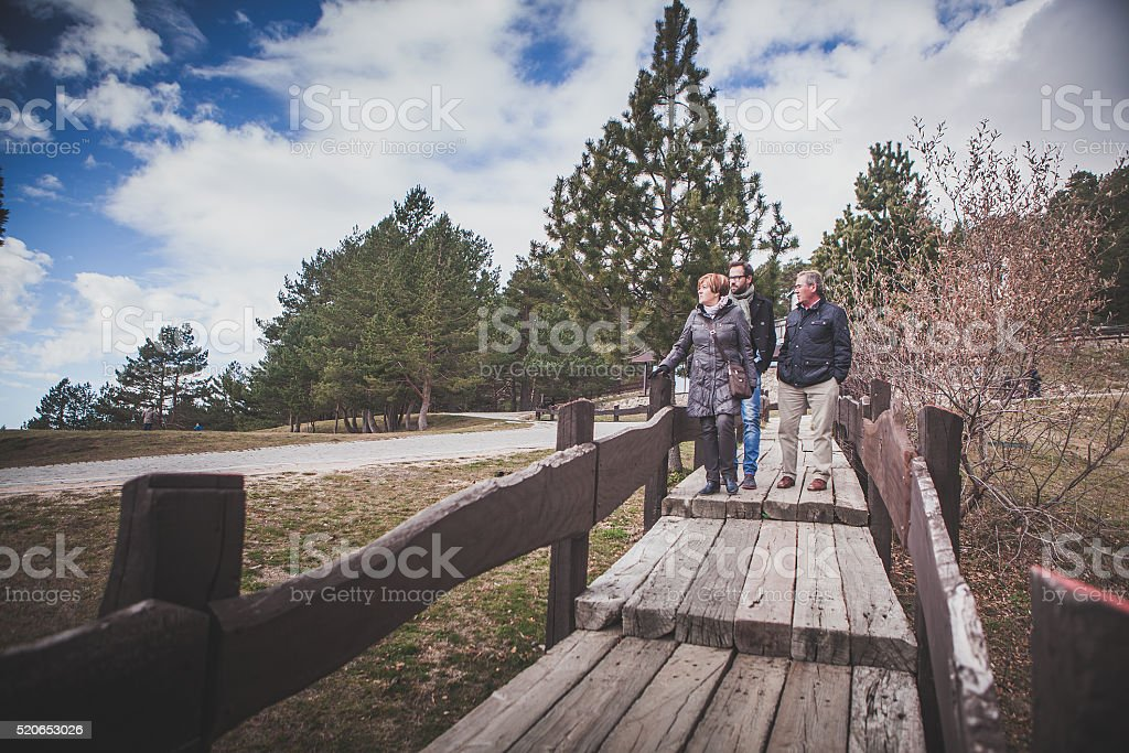 Family walk in the mountain range. stock photo