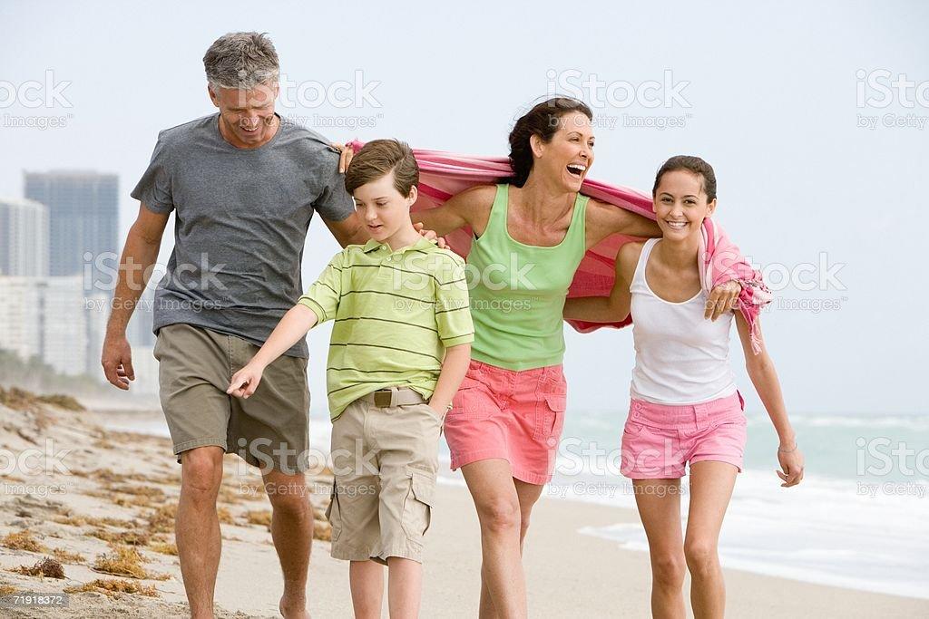 Family walking along beach stock photo