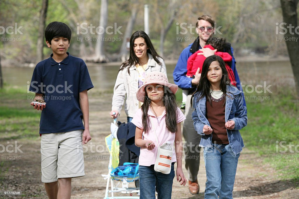 Family walking along country path stock photo