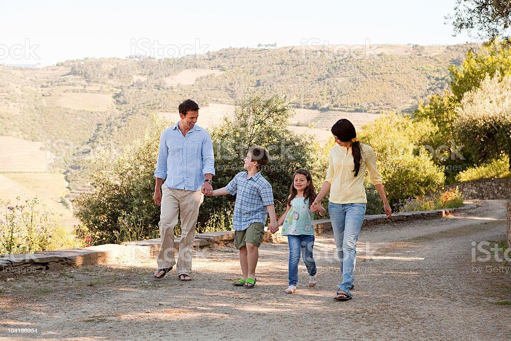 Family walking down rural lane on holiday royalty-free stock photo