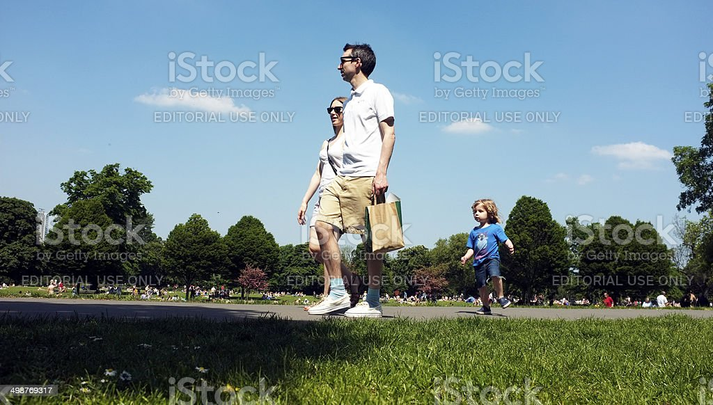 Family walking in a park under the blue sky stock photo