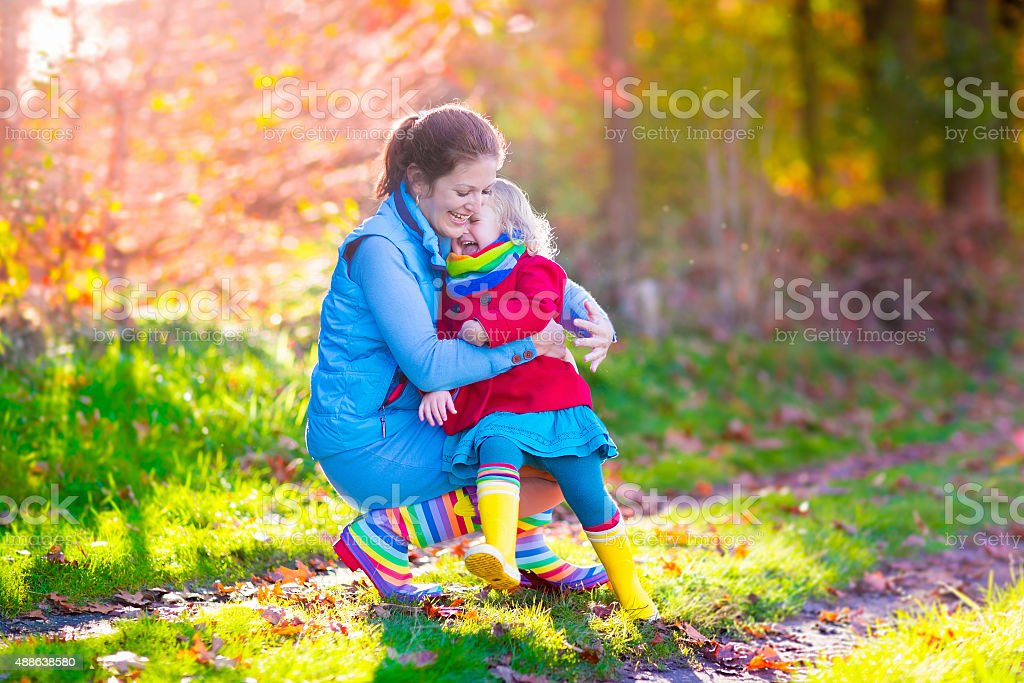Family walking in autumn park stock photo