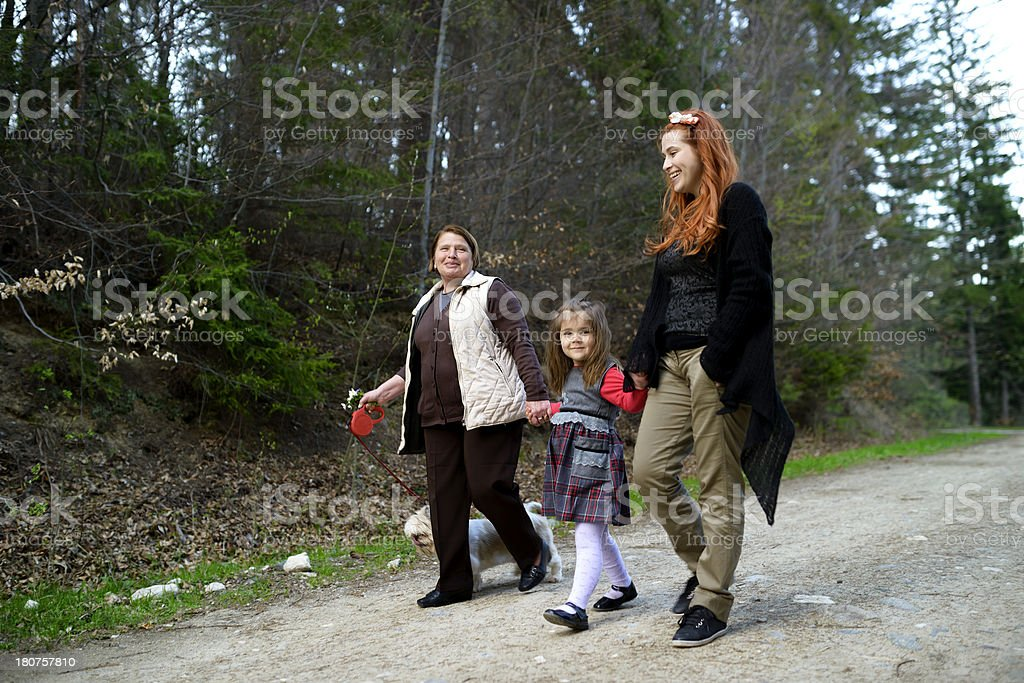 family walking in forest royalty-free stock photo