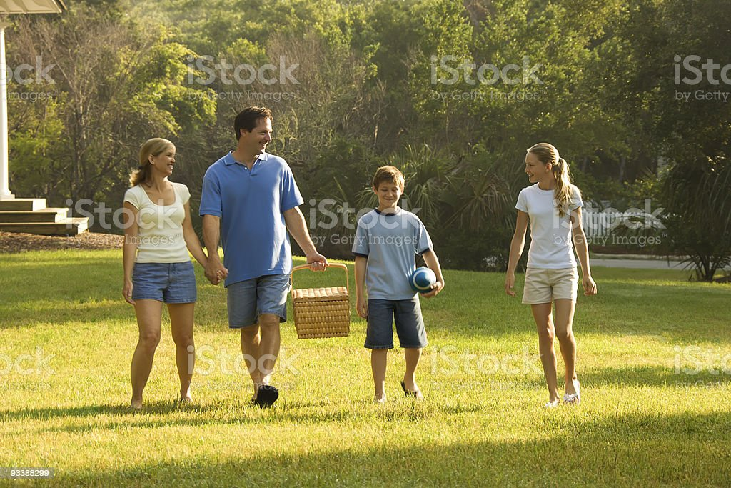 Family walking in park. royalty-free stock photo