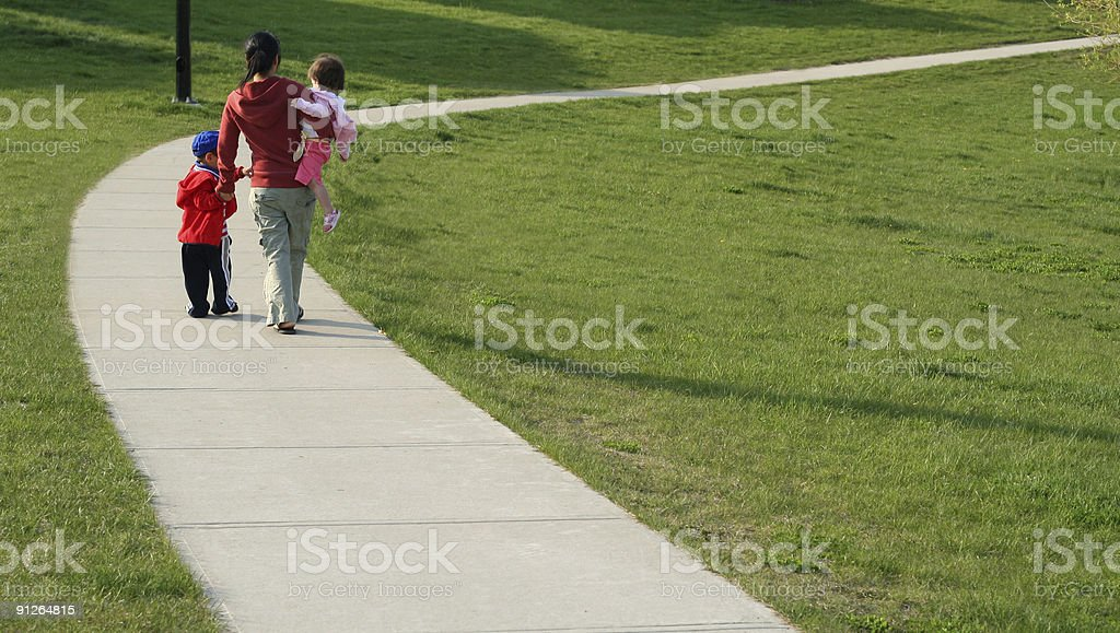Family walking in the park royalty-free stock photo