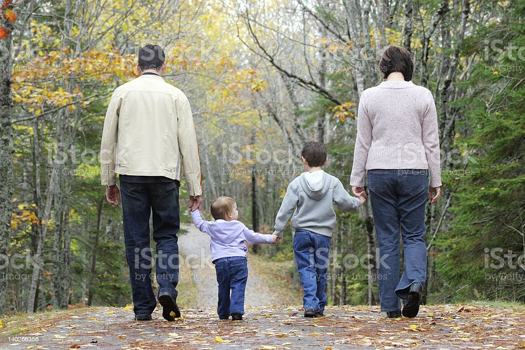 Family Walking in Woods royalty-free stock photo