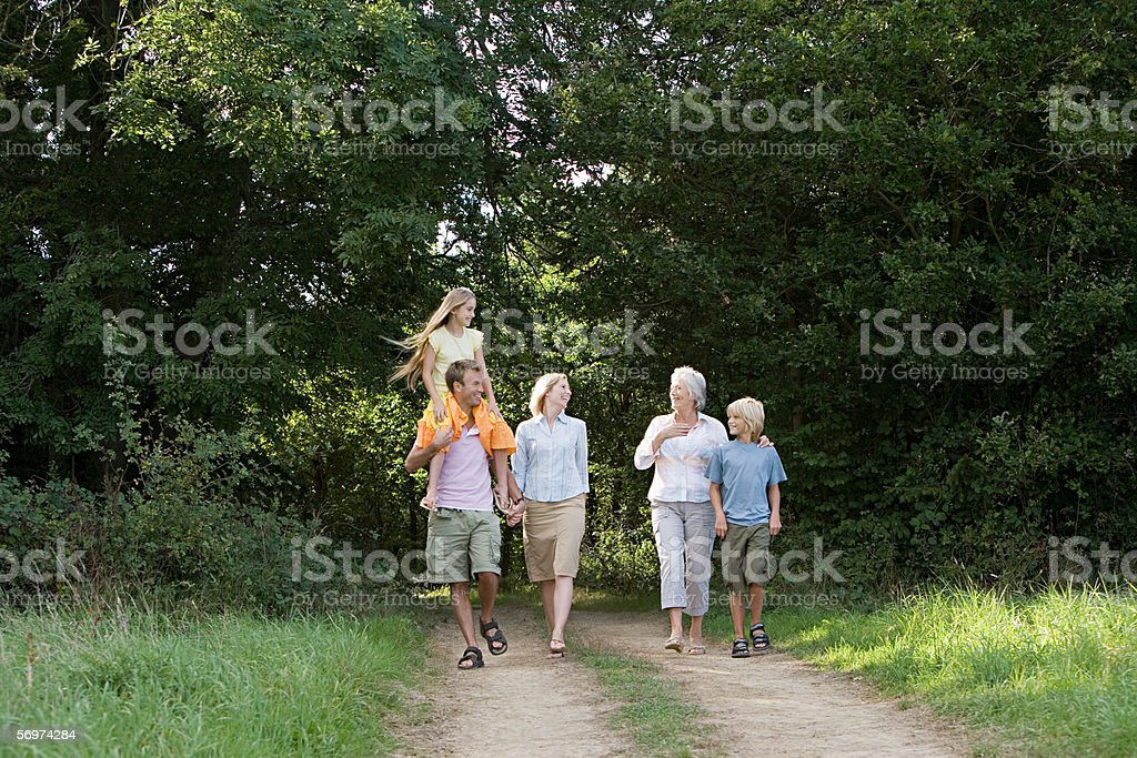 Family walking on a dirt track stock photo