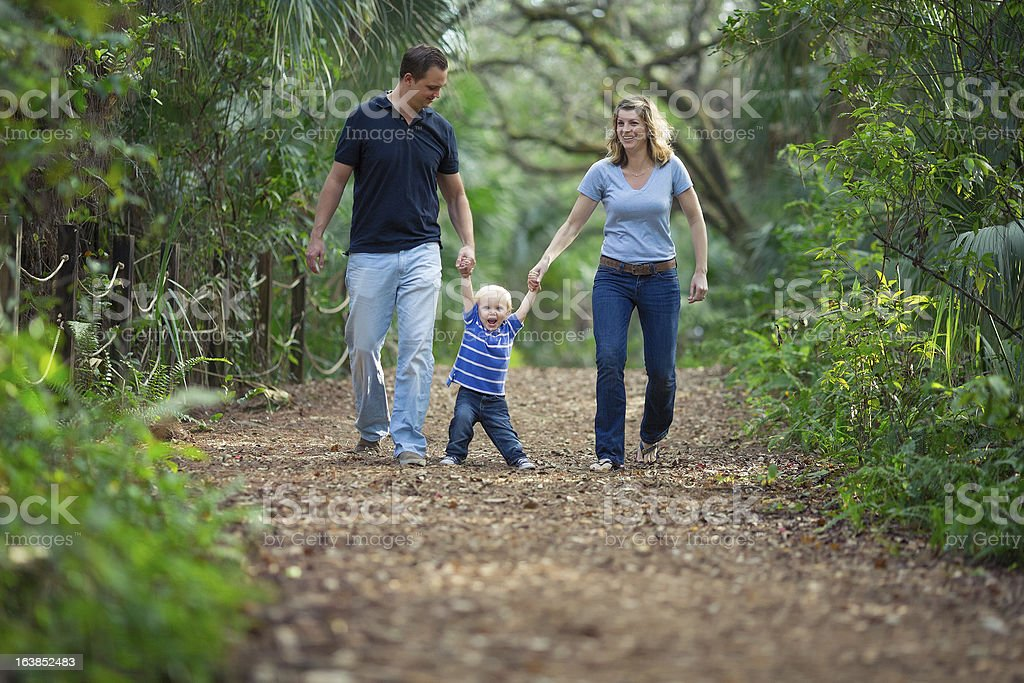 family walking on a park royalty-free stock photo