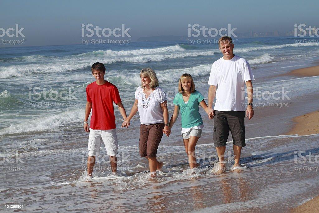 family walking on beach royalty-free stock photo